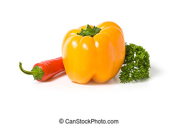 Yellow and red peppers with a sprig of parsley isolated