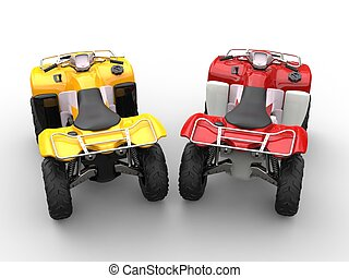 Yellow and red quad bikes - top view