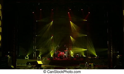Yellow and red stage lights. Scene, stage light with spotlights and smoke.