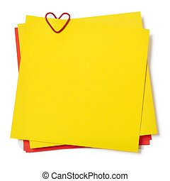 yellow and red sticky notes with paper clip in shape of...