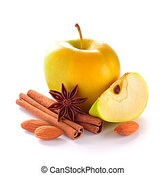 Yellow Apple with Apple Slice, Almond Nuts, Cinnamon Sticks and Anise on the White Background