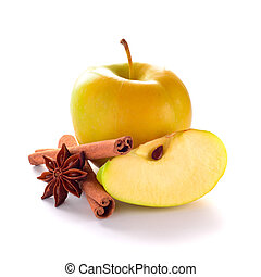 Yellow Apple with Apple Slice, Cinnamon Sticks and Anise on the White Background