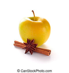 Yellow Apple with Cinnamon Stick and Anise on the White Background