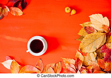 yellow autumn leaves Tea Cup on a red background