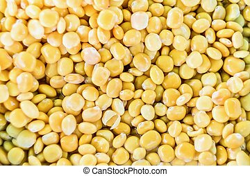 Yellow background made of lupin beans in salted water