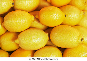 background, texture of many lemons in market