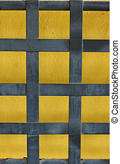 Yellow background with blue striped on a wall
