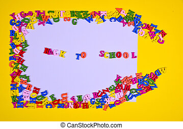 Yellow background with multi-colored wooden letters