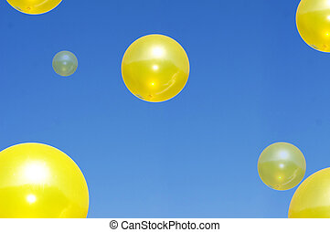Yellow balls in blue sky - Large Yellow spheres floating in ...