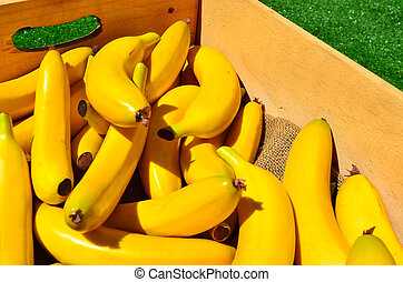 Yellow bananas in a wooden box