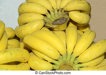 Yellow bananas (Musa acuminata balbisiana paradisiaca) fruit vegetarian food.