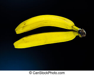 Yellow bananas on a black background.