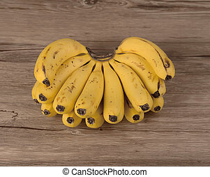 Yellow bananas on wooden background