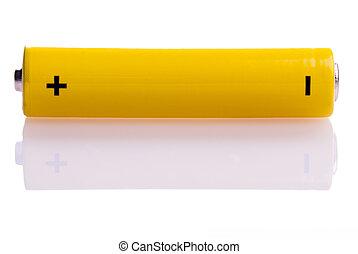 yellow battery lying across