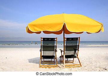 Yellow Beach Brolly - Yellow beach umbrella and deckchairs