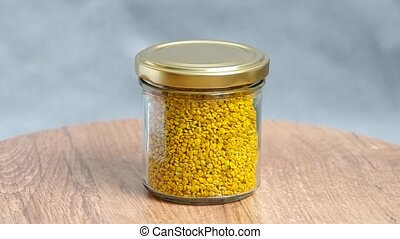 Yellow bee pollen in glass.