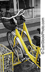 Yellow bicycles - Two yellow bicycles parked in their...