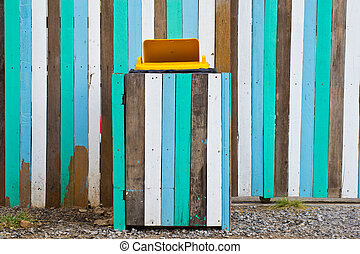 Yellow bins. Multicolored wooden.