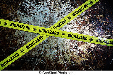 biohazard - Yellow biohazard tape across and grunge metal...