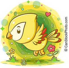 Yellow bird flying in the garden