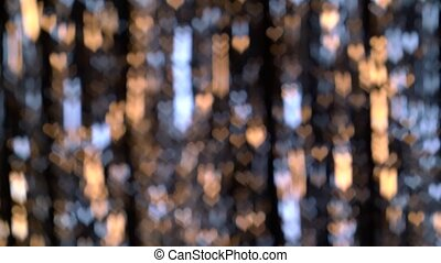 Yellow, blue hearts and glitter lights. Bokeh background