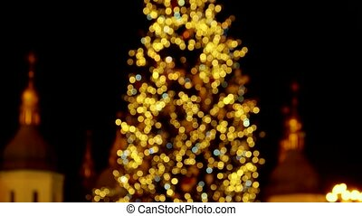 Yellow blurred lights on the christmas tree.