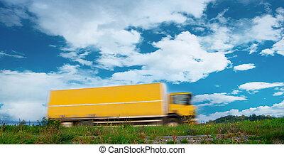 Yellow blurred truck