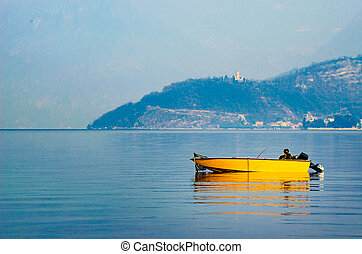 yellow boat misty waters lake winter sport fishing vacations
