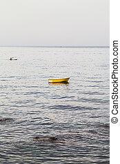 yellow boat near waterfront in Giardini Naxos - travel to...