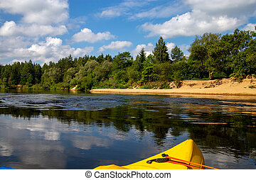 Yellow boat ride by the river. - Kayak and canoe ride in...