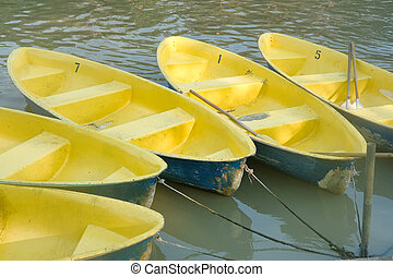 yellow boats on river