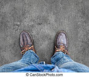 Yellow boots on the road