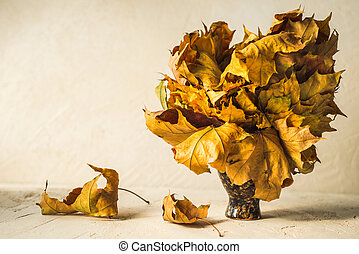 bouquet of dry autumn leaves on background