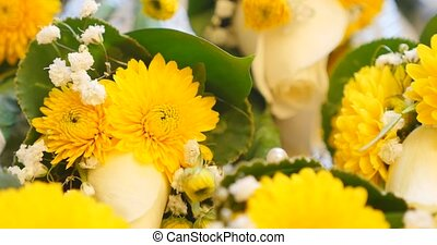 yellow bouquets on white table