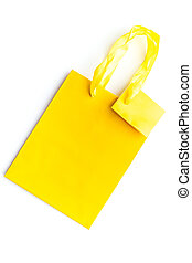 Yellow bright shopping bag on white background top view mockup