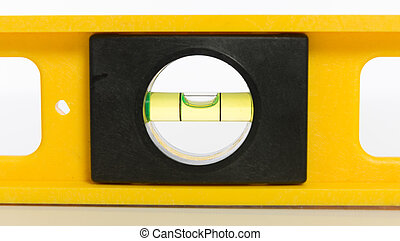 A yellow bubble level on a white background