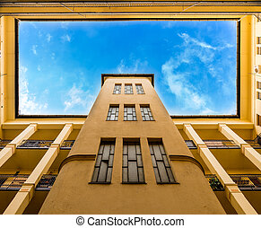 Yellow building and blue sky