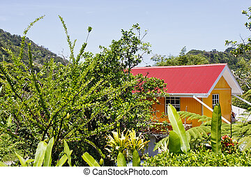 Yellow Building with Red Roof in Tropical Garden