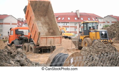 Yellow bulldozer working on construction site