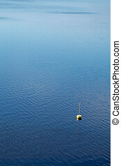 Yellow buoy in the water