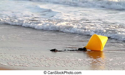 Yellow buoy in the waves