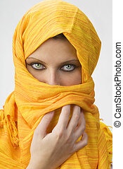 yellow burka - attactive and strong eyes behind an orange...