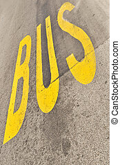 Yellow Bus sign painted on the asphalt