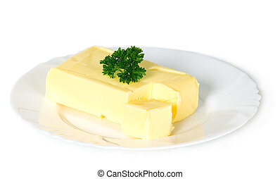 Yellow butter with parsley placed on plate, food concept