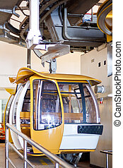 Yellow cabin on cable car station, genting mountains malaysia