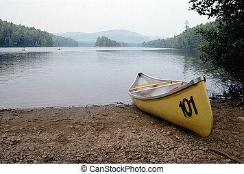 Yellow canoe and canadian lake