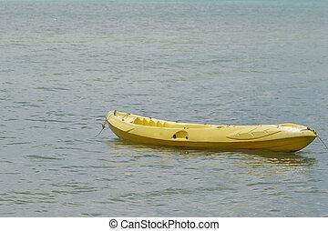 Yellow Canoe on the beach