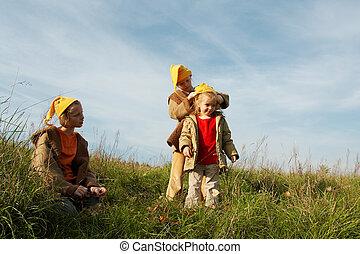 Yellow caps gnomes - Children wearing yellow caps playing on...