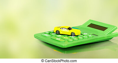 Yellow car and calculator.