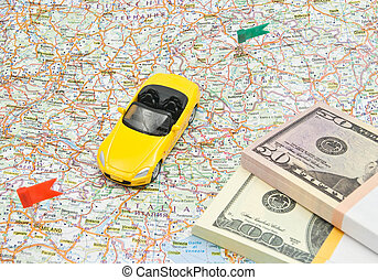 yellow car and money on map